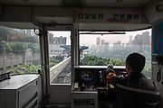 A conductor operates in the control room of a CRT Chongqing Rapid Transit monorail in Chongqing, China, on Thursday, April 14, 2016. The municipality of 30 million people saw state-led development approach fueled the fastest pace nationwide, with President Xi Jinping praising policy innovations that have included subsidized housing and relaxed residency rules that encourage labor mobility.