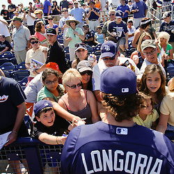 March 20, 2011; Port Charlotte, FL, USA; Tampa Bay Rays third baseman Evan Longoria (3) signs autographs for fans before a spring training exhibition game against the Baltimore Orioles at Charlotte Sports Park.  Mandatory Credit: Derick E. Hingle-US PRESSWIRE