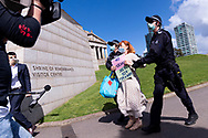 MELBOURNE, VIC - SEPTEMBER 05: A woman is taken into custody for protesting and disobeying the stage 4 restriction laws during the Anti-Lockdown Protest on September 05, 2020 in Melbourne, Australia. Stage 4 restrictions are in place from 6pm on Sunday 2 August for metropolitan Melbourne. This includes a curfew from 8pm to 5am every evening. During this time people are only allowed to leave their house for work, and essential health, care or safety reasons. (Photo by Mikko Robles/Speed Media)