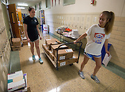 Volunteers distribute text books in preparation for the first day of school at Condit Elementary School, August 19, 2014.