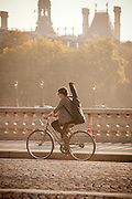 A cyclist on an early morning commute in the centre of Paris, France