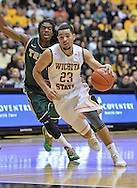 WICHITA, KS - NOVEMBER 14:  Guard Fred VanVleet #23 of the Wichita State Shockers drives past guard Marcus Thornton #3 of the William & Mary Tribe during the first half on November 14, 2013 at Charles Koch Arena in Wichita, Kansas.  Wichita State defeated William & Mary 79-62. (Photo by Peter Aiken/Getty Images) *** Local Caption *** Fred VanVleet;Marcus Thornton