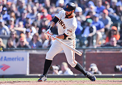 April 29, 2018 - San Francisco, CA, U.S. - SAN FRANCISCO, CA - APRIL 29: San Francisco Giants First base Brandon Belt (9) check swings during the San Francisco Giants and Los Angeles Dodgers game at AT&T Park on April 29, 2018 in San Francisco, CA.  (Photo by Stephen Hopson/Icon Sportswire) (Credit Image: © Stephen Hopson/Icon SMI via ZUMA Press)