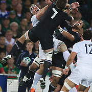 Imanol Harinordoquy, France, challenges Richie McCaw, (centre) and Jerome Kaino, New Zealand for a high ball during the New Zealand V France Final at the IRB Rugby World Cup tournament, Eden Park, Auckland, New Zealand. 23rd October 2011. Photo Tim Clayton...