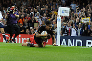Julian Savea  of New Zealand dives over to score a try in 2nd half. Rugby World Cup 2015 pool c match, New Zealand v Georgia at the Millennium Stadium in Cardiff, South Wales  on Friday 2nd October 2015.<br /> pic by  Andrew Orchard, Andrew Orchard sports photography.