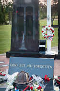 Washingtonville, N.Y. - Flowers and <br />  wreaths were placed at the Washingtonville 5 Firefighters World Trade Center Memorial for a candlelight service on Sept. 11, 2017. The Memorial was built in honor of five FDNY firefighters from Washingtonville and the many others who lost their lives on September 11, 2001 in the World Trade Center terrorist attack.