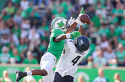 Oct 9, 2021; Huntington, West Virginia, USA; Marshall Thundering Herd defensive back Micah Abraham (6) breaks up a pass intended for Old Dominion Monarchs quarterback Stone Smartt (4) during the third quarter at Joan C. Edwards Stadium. Mandatory Credit: Ben Queen-USA TODAY Sports