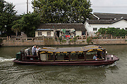 A canal boat on the Grand Canal in Suzhou, China.