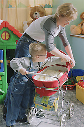 Young boy with Cerebral Palsy playing with mother on Children's ward in hospital,