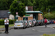 MERTHYR TYDFIL, WALES 03 JUNE 2020 - Cars queue to get a Mcdonalds drive through as store re open during the covid-19 epidemic.