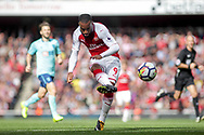 Alexandre Lacazette of Arsenal shoots and scores Arsenal's 2nd goal of the game . Premier league match, Arsenal v AFC Bournemouth at the Emirates Stadium in London on Saturday 9th September 2017. pic by Kieran Clarke, Andrew Orchard sports photography.