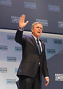 Republican presidential candidate Gov. Jeb Bush waves to supporters at the Heritage Foundation Take Back America candidate forum September 18, 2015 in Greenville, South Carolina. The event features 11 presidential candidates but Trump unexpectedly cancelled at the last minute.