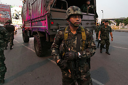 © Licensed to London News Pictures. 26/05/2014. A thai army soldier on guard  during a Anti-Coup protest in Bangkok Thailand. Today Thailand's King formally approved Thai army chief General Prayut Chan-O-Cha as head of the nation's new military junta.  Photo credit : Asanka Brendon Ratnayake/LNP