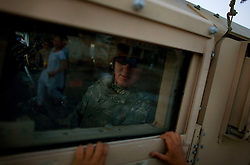 A young boy in Adhamiya appeals for soccer balls, candy, money or anything else he can get from a soldier driving a Humvee with a passing patrol from Charlie Co. 1-26 Infantry 1st Infantry Division on Thursday April 27, 2007.