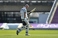 Adam Lyth of Yorkshire looks dejected as he walks back to the pavilion after being dismissed by Fidel Edwards of Hampshire during the Specsavers County Champ Div 1 match between Hampshire County Cricket Club and Yorkshire County Cricket Club at the Ageas Bowl, Southampton, United Kingdom on 11 April 2019.