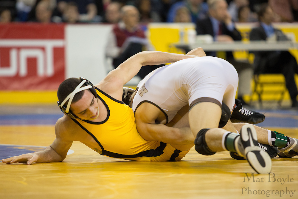 Mike Magaldo of Watchung Hills (white) defeats Gennaro Cuccolo of Hanover Park in the 126lb 3rd place match in the NJ State Wrestling Tournament at Boardwalk Hall in Atlantic CIty, NJ on Sunday March 10, 2013. (photo / Mat Boyle)