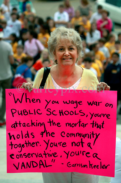 30 April 2013. Baton Rouge, Louisiana,  USA. .March on Baton Rouge, Enough is Enough. .Marta Badon, a retired Orleans parish school teacher attends a coalition of 40 Louisiana Organisations protesting what many believe to be the 'Economic and fiscal disaster that is the administration of Governor Bobby Jindal.' Top of the agenda,  Jindal's refusal to accept the expansion of MEDICAID, instead denying coverage to over 400,000 citizens with Jindal refusing to accept federal funding for  'Obamacare.' Slashed state spending on education, social services and critical community based organisations is having far reaching and devastating effects on ordinary and poor citizens in Louisiana..Photo; Charlie Varley.