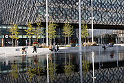 As numbers of Covid-19 cases in Birmingham have dramatically risen in the past weeks, increased lockdown measures have been announced for Birmingham and other areas of the West Midlands, people enjoy the fountains in Centenary Square in front of the Library of Birmingham while the city centre is still very quiet on 29th September 2020 in Birmingham, United Kingdom. With the rule of six also being implemented the Birmingham area has now be escalated to an area of national intervention, with a ban on people socialising with people outside their own household, unless they are from the same support bubble.