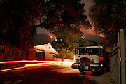 5 May 2009 - Santa Barbara, CA - Fire engine stands by for structure protection as the  Jesusita fire burns near homes in the foothills of Santa Barbara, California. Photo Credit: Rod Rolle/Sipa Press,  21 August 2009-Santa Barbara, CA: