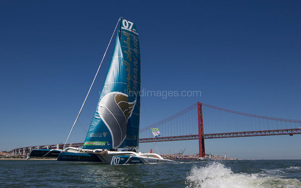 La Route des Princes. Lisbon. Portugal.<br /> The Oman Air - Musandam MOD70. Pictured racing close to the city today. Skippered by Sidney Gavignet  (FRA) with team mates Thomas LeBreton (FRA), Fahad Al Hasni (OMA), Neal McDonald (GBR),Damian Foxall (IRL), Philip Rivett (AUS), Ahmed Al Hassani (OMA) and Giles Favennec (FRA)<br />  <br /> Credit: Lloyd Images