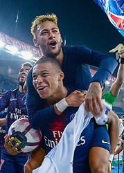 October 8, 2018 - Paris, France - Paris Saint Germain team mates NEYMAR JR, top, and KYLIAN MBAPPE celebrate a 5:0 France Ligue 1 win over Olympique Lyonnais. (Credit Image: © Panoramic via ZUMA Press)