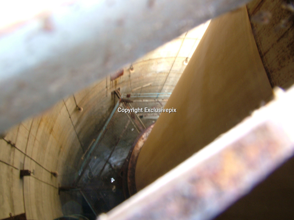 The Secret 10-Story Space Rocket Buried in the Swamps of Florida<br /> <br /> Sitting in a huge hole in the ground in the swampy Florida Everglades is the largest solid rocket booster ever built. Standing 10 stories tall and about 20 feet wide, the rocket was originally intended to carry men to the moon. Aerojet-General reportedly built the rocket manufacturing plant in 1963, hoping to build solid fuel rockets for the Apollo moon mission. In the end, NASA chose liquid fueled Saturn rockets and Aeroject never got the contract. The site was abandoned in 1969, along with the rocket in its 150-foot deep testing silo, where it has remained for more than 40 years.<br /> (Credit Image: © Fred Szabries/Exclusivepix)