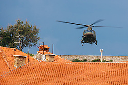After two months of restoration, the Statue of Archangel Michael, made of copper plate, returned to Piran. The image shows helicopter taking off next to the St. George's Parish Church, on October 15, 2018 in Piran, Slovenia. Photo by Matic Klansek Velej / Sportida