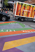 A Sainsbury's delivery van with carrots on its side, halts just over a striped pedestrian crossing in Paccadilly Circus, on 14th October, 2021, in Westminster, London, England.
