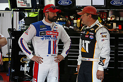 April 27, 2018 - Talladega, Alabama, United States of America - Paul Menard (21) and Ryan Newman (31) hang out in the garage during practice for the GEICO 500 at Talladega Superspeedway in Talladega, Alabama. (Credit Image: © Justin R. Noe Asp Inc/ASP via ZUMA Wire)