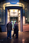 People gather outside the crypt at St Martin in the Fields, London
