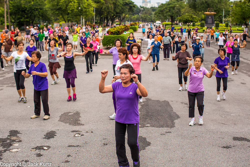 06 OCTOBER 2012 - BANGKOK, THAILAND: A public exercise class in Lumphini Park in Bangkok. Lumphini Park is 142 acre (57.6-hectare) park in Bangkok, Thailand. This park offers rare open public space, trees and playgrounds in the congested Thai capital. It contains an artificial lake where visitors can rent boats. Exercise classes and exercise clubs meet in the park for early morning workouts and paths around the park totalling approximately 1.55 miles (2.5km) in length are a popular area for joggers. Cycling is only permitted during the day between the times of 5am to 3pm. Smoking is banned throughout the park. The park was created in the 1920's and named after Lumbini, the birthplace of the Buddha in Nepal.   PHOTO BY JACK KURTZ
