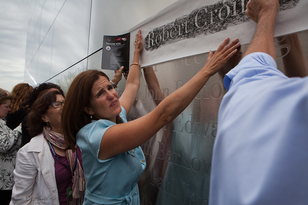 Mary Pat Christie helps make a rubbing off one of the names etched in stainless steel of the 746 New Jerseyans who perished after the terrorist attacks on 9/11, 2001 during the opening of the Empty Sky Memorial 9/11 Memorial at Liberty State Park in New Jersey on  September 10th 2011 for the tenth anniversary of 9/11.The memorial is two 30-Ft rectangular towers  208 feet by 10 inches long,  the width of the World Trade Center towers and with the names of the 746 New Jerseyans who perished after the terrorist attacks on 9/11, 2001.
