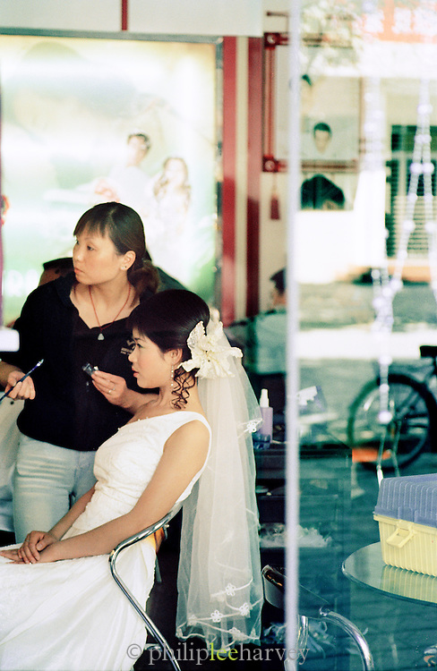A bride gets ready for her wedding day at a beauty salon in Dunhuang, Gansu Province, China
