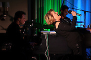 """V001473775. Lorna Luft performs """"Songs My Mother Taught Me: The Judy Garland Songbook"""" with Colin Freeman, left, on piano and Steve Moretti, right, on drums at Feinstein's at Loews Regency Hotel, NYC. January 4, 2011. Copyright © 2011 Matthew Eisman/ The New York Times. All Rights Reserved."""