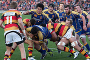 Kees Meeuws drives hard into Brendon Leonard and Romana Graham  during their Round 9 ITM cup Rugby match, Waikato v Otago, at Waikato Stadium, Hamilton, New Zealand, Sunday 13 August  2011. Photo: Dion Mellow/photosport.co.nz
