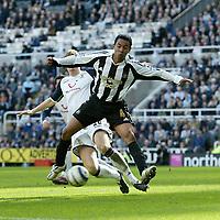 Photo: Andrew Unwin.<br />Newcastle United v Tottenham Hotspur. The Barclays Premiership. 01/04/2006.<br />Tottenham's Michael Dawson tackles Newcastle's Nolberto Solano (R).