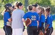 Middletown, New York - A Middletown coach talks to players during a varsity girls' softball game on May 19, 2014.