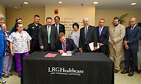 Governor Chris Sununu signing bill NB1791 at Lakes Region General Hospital on Thursday morning.  (Karen Bobotas/for the Laconia Daily Sun)