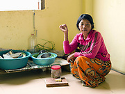 Ren Way, 26 in the kitchen of her new home. Ren Way and her husband Soo Tou, 29 are from Sre Sronuk Village close to the Sesan River in Streung Treng province, north-eastern Cambodia. 5000 people from 20 villages are being evicted from their homes to make way for a controversial huge new hydropower dam: 'Lower Sesan 2', which will flood an area of more than 33,000 square hectares. The young, newly-married couple accepted the dam company's offer to relocate them in a new concrete house and are among the first few residents of the mostly-empty, half-constructed resettlement site. Communities in this rural region are seeing their traditional self-sufficient farming and fishing lifestyle disrupted by dam building and the impact of climate change on crops, water quality and fish stocks.