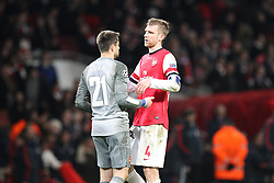 19.02.2014, Emirates Stadion, London, ENG, UEFA CL, FC Arsenal vs FC Bayern Muenchen, Achtelfinale, im Bild l-r: enttaeuschung bei Lukasz FABIANSKI #21 (FC Arsenal London), Per MERTESACKER #4 (FC Arsenal London) // during the UEFA Champions League Round of 16 match between FC Arsenal and FC Bayern Munich at the Emirates Stadion in London, Great Britain on 2014/02/19. EXPA Pictures © 2014, PhotoCredit: EXPA/ Eibner-Pressefoto/ Kolbert<br /> <br /> *****ATTENTION - OUT of GER*****