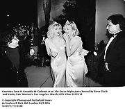 Courtney Love & Amanda de Cadenet at at  the Oscar Night party hosted by Steve Tisch and Vanity Fair. Morton's. Los Angeles. March 1995. Film. 95555/35<br />