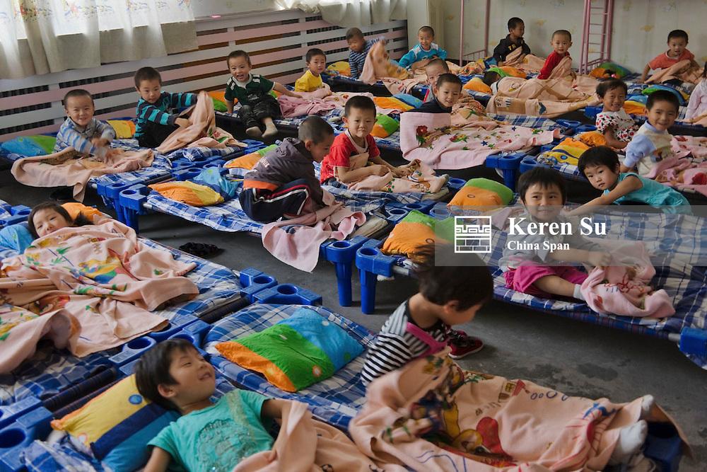 Children take a nap in the kindergarten, Dunhuang, Gansu Province, China