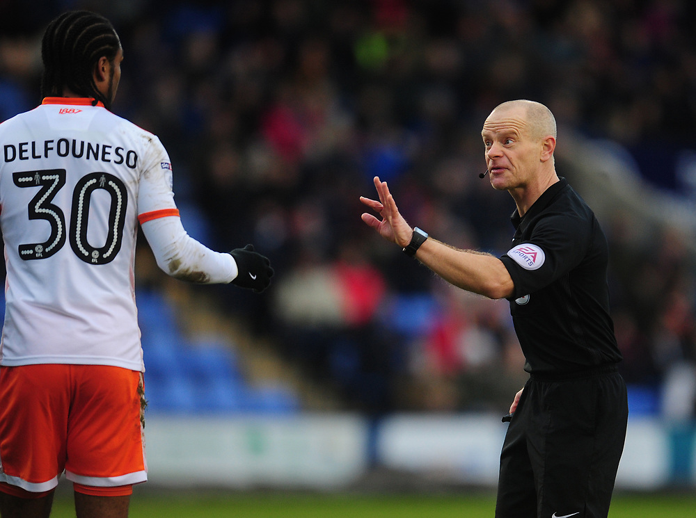 Referee Andy Woolmer remonstrates with Blackpool's Nathan Delfouneso<br /> <br /> Photographer Kevin Barnes/CameraSport<br /> <br /> The EFL Sky Bet League One - Shrewsbury Town v Blackpool - Saturday 16th December 2017 - New Meadow - Shrewsbury<br /> <br /> World Copyright © 2017 CameraSport. All rights reserved. 43 Linden Ave. Countesthorpe. Leicester. England. LE8 5PG - Tel: +44 (0) 116 277 4147 - admin@camerasport.com - www.camerasport.com