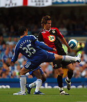 Photo: Tony Oudot.<br /> Chelsea v Blackburn Rovers. The FA Barclays Premiership. 15/09/2007.<br /> Morten Gamst- Pedersen of Blackburn clears from Juliano Belletti of Chelsea
