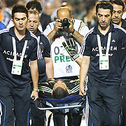 Fenerbahce's goal keeper Volkan is out of play according to a problem on his shoulder during their Turkish Super Cup 2012 soccer derby match Galatasaray between Fenerbahce at the Kazim Karabekir stadium in Erzurum Turkey on Sunday, 12 August 2012. Photo by TURKPIX