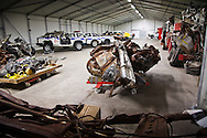 Room full of destroyed emergency response vehicles and taxi cabs that are part of a collection of artifacts saved from the site of the World Trade Center after 9/11. Artifacts chosen by curators out of the wreckage  from the World trade Center  stored temporarily within an 80,000 square foot hanger at JFK airport, Hanger 17. Some of the artifacts will be in the National September 11 Memorial Museum set to open in 2012.