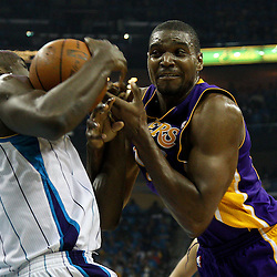 April 28, 2011; New Orleans, LA, USA; New Orleans Hornets center Emeka Okafor (50) and Los Angeles Lakers center Andrew Bynum (17) battle for possession during the second quarter in game six of the first round of the 2011 NBA playoffs at the New Orleans Arena.    Mandatory Credit: Derick E. Hingle