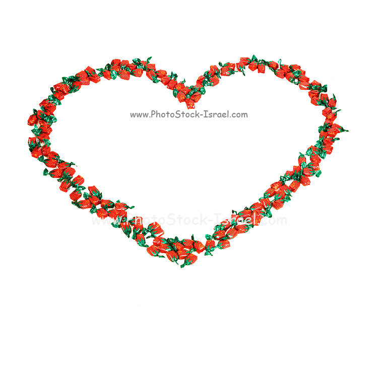 Heart shape formed from sweets on white background