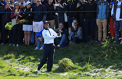 Team USA's Tiger Woods hits from the rough on the 5th during the Foursomes match on day two of the Ryder Cup at Le Golf National, Saint-Quentin-en-Yvelines, Paris.