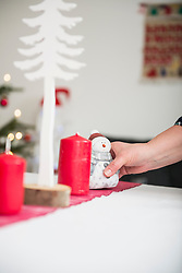 Woman decorating Christmas table